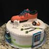 "16"" 3 Layer Vanilla Pound Cake Vanilla ButterCream Filling/Frosting Decorations: Running Shoe (Rice Krispies) Fondant/Gumpaste Watch, Water Bottle, Ipod, Head Phones, Band, etc"