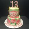 2 Tier Happy 13th Birthday! Bottom Layer Vanilla Pound Cake with Vanilla ButterCream Filling. Top Layer Chocolate Fudge Cake w/Raspberry Mousse Filling and Rough  Coat of Light Green Vanilla ButterCream Frosting Decorations:  Lilly Pulitzer