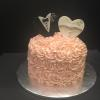 "9"" Strawberry Cake with Strawberry Cream Cheese Filling and Champagne ButterCream Frosting Decoration:  Fondant Bride and Groom Hearts"