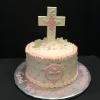 First Communion Cake Butter Almond Pound Cake with Raspberry Mousse Filling and Vanilla ButterCream Frosting. First Communion Cross made from White Chocolate Candy