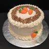 Carrot Cake with Cream Cheese Filling and Cream Cheese Frosting Decorated with toasted chopped nuts!