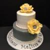 Beautiful Yellow, Grey and White 2 Tier Bridal Shower Cake -  Red Velvet Cake with Middle Layer of  delicious creamy CheeseCake! Frosted with Vanilla ButterCream and decorated with large yellow fantasy gumpaste flowers.