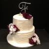 2  Tier Wedding Cake delivered    Fort Mill, South Carolina  Top Tier Butter Almond Cake with Vanilla ButterCream Filling Bottom Tier Vanilla Pound Cake with Lemon Curd/Raspberry Glaze Filling Vanilla ButterCream Frosting.  Decorations Initial Cake Topper and Silk Flowers White/Dark Plum.