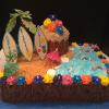 11 x 15 Happy Birthday Chocolate Fudge with Vanilla ButterCream Filling/Frosting  Decorations: Palm Tree, Tike Hut, Shells, Fish, Surf Boards