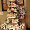 "80 Christmas cupcakes! Tower with a 6"" Vanilla Pound Cake w/Raspberry Glaze Filling and Vanilla ButterCream Frosting"