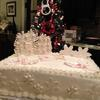 Beautiful White Christmas Cake.  Double Layer Butter Almond Cake with Raspberry Filling and Butter Cream Frosting.