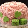 This is a St. Patrick's Day Cake for a Bunco Party.  It is a  Strawberry Cake with Strawberry Cream Cheese Filling and Pink Champagne Frosting.