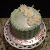 This April / Spring Birthday Cake is an Almond Cake with Vanilla Filling and Frosting.  It is decorated with Wafer Paper Butterflies and Fondant Daisies.