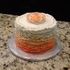 This is a Spring Celebration Cake.  It is a Poppy Seed Cake with Orange Buttercream.