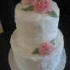 This is an elegant May Wedding Cake.  It is done in a rough-coating technique.