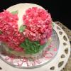 This is a beautiful Spring Birthday Cake.  It is a strawberry cake with pink hydrangeas.  It has strawberry cream cheese filling and vanilla buttercream frosting.