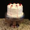 This Neapolitan Cake has layers of strawberry cake with chocolate mouse filling - vanilla cake with strawberry cream filling and chocolate cake, vanilla buttercream outside and cherries on top.