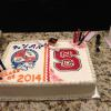 This graduation cake serves 50 people. It is a double layer vanilla pound sheet cake with raspberry filling.
