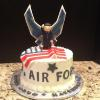 This graduation cake is chocolate marble. Buttercream with vanilla buttercream frosting.  The soldier wings and flag are fondant.