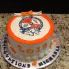 This graduation cake is a butter almond pound cake with vanilla buttercream filling and frosting.